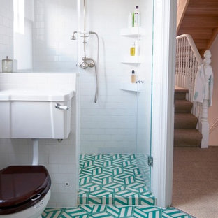 Photo of a contemporary bathroom in London with an alcove shower, a two-piece toilet, multi-coloured tiles, white walls and a hinged door.