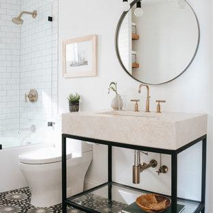 This is an example of a medium sized contemporary family bathroom in Other with open cabinets, an alcove bath, a shower/bath combination, a two-piece toilet, white tiles, porcelain tiles, white walls, cement flooring, a console sink, marble worktops, multi-coloured floors, an open shower and beige worktops.