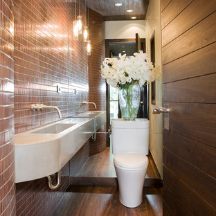 Contemporary bathroom in Denver with a wall-mounted sink and brown tiles.