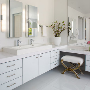 Bathroom - mid-sized contemporary master white floor bathroom idea in San Diego with a trough sink, flat-panel cabinets, white cabinets, white walls, solid surface countertops and white countertops