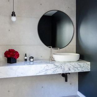 Bathroom - contemporary bathroom idea in Los Angeles with black walls, a vessel sink and white countertops