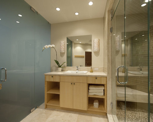 inspiration for a gray tile alcove shower remodel in los angeles with a drop