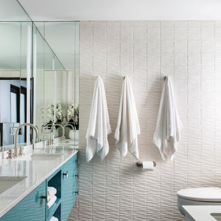 Example of a trendy master gray floor bathroom design in Los Angeles with flat-panel cabinets, turquoise cabinets, white walls and an undermount sink