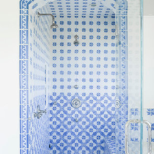 Mediterranean bathroom in Los Angeles with an alcove shower, white walls and blue tiles.