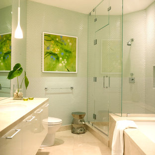 Coastal green tile and mosaic tile corner shower photo in Los Angeles with flat-panel cabinets, white cabinets and an undermount tub