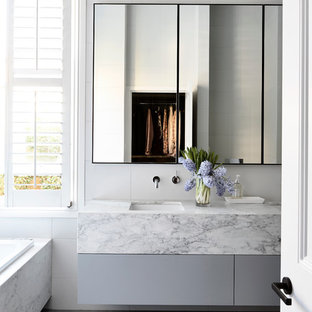 Inspiration For A Contemporary Drop In Bathtub Remodel Melbourne With Flat Panel Cabinets