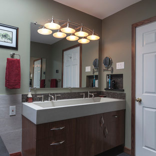 Example of a mid-sized trendy master black tile and porcelain tile porcelain tile walk-in shower design in Bridgeport with a trough sink, flat-panel cabinets, medium tone wood cabinets, concrete countertops, a two-piece toilet and gray walls