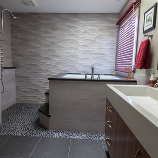 Bathroom - mid-sized contemporary master black tile and porcelain tile porcelain tile bathroom idea in Bridgeport with a trough sink, flat-panel cabinets, medium tone wood cabinets, concrete countertops, a two-piece toilet and gray walls