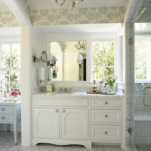 This is an example of a large traditional master bathroom in Minneapolis with mosaic tile, shaker cabinets, white cabinets, white walls, marble floors, an undermount sink and marble benchtops.