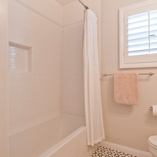 Design ideas for a small classic family bathroom in Los Angeles with shaker cabinets, white cabinets, a built-in bath, a shower/bath combination, a one-piece toilet, white tiles, ceramic tiles, beige walls, terracotta flooring, a submerged sink, engineered stone worktops, multi-coloured floors, a shower curtain and white worktops.