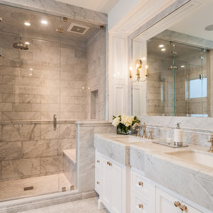 Design ideas for a large country ensuite bathroom in Los Angeles with recessed-panel cabinets, white cabinets, an alcove shower, grey tiles, marble tiles, white walls, marble flooring, a submerged sink, marble worktops, white floors, a hinged door and white worktops.