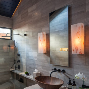 This is an example of a world-inspired bathroom in Los Angeles with a vessel sink.