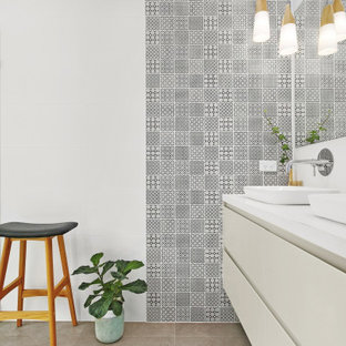 Design ideas for a contemporary bathroom in Sydney with flat-panel cabinets, white cabinets, black and white tile, a vessel sink, grey floor and white benchtops.