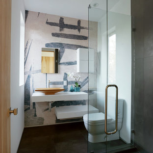 Small trendy 3/4 porcelain floor corner shower photo in Los Angeles with a vessel sink, open cabinets, white cabinets, white walls, a two-piece toilet and solid surface countertops