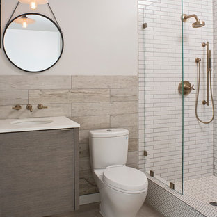 Trendy 3/4 white tile and subway tile alcove shower photo in Other with an undermount sink, flat-panel cabinets, a two-piece toilet and white walls