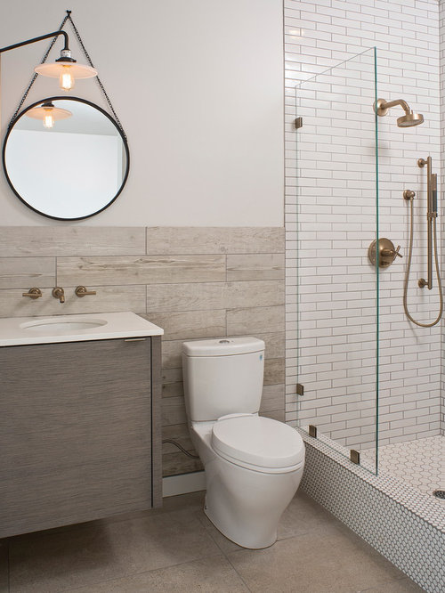 trendy 34 white tile and subway tile alcove shower photo in other with an