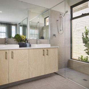 Design ideas for a contemporary bathroom in Perth with flat-panel cabinets, light wood cabinets, an alcove shower, gray tile, a vessel sink, grey floor, white benchtops, a double vanity and a built-in vanity.