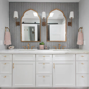 Inspiration for a mid-sized transitional master gray tile and glass tile marble floor and white floor alcove shower remodel in San Diego with recessed-panel cabinets, white cabinets, a one-piece toilet, gray walls, an undermount sink, marble countertops, a hinged shower door and white countertops