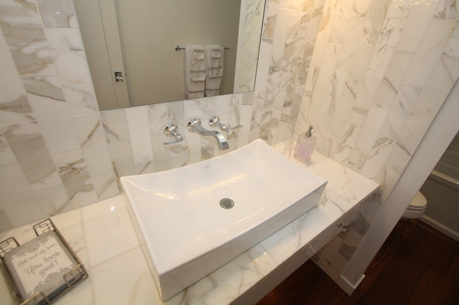 Contemporary Powder Room by Architectural Justice