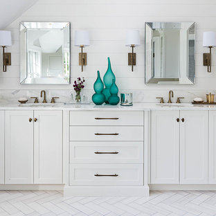 Inspiration for a farmhouse master marble floor and white floor bathroom remodel in New York with recessed-panel cabinets, white cabinets, gray walls, an undermount sink and quartzite countertops