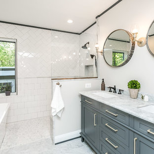 Bathroom - transitional master white tile and subway tile marble floor and gray floor bathroom idea in Baltimore with shaker cabinets, gray cabinets, white walls, marble countertops, an undermount sink and gray countertops