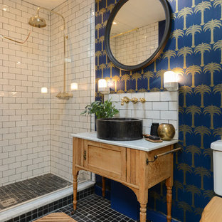 Inspiration for a small eclectic 3/4 bathroom in Kent with a two-piece toilet, subway tile, multi-coloured walls, a vessel sink, black floor, an open shower, furniture-like cabinets, light wood cabinets, an alcove shower and white tile.