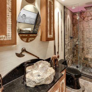 Eclectic alcove shower photo in New York with a one-piece toilet, beige walls, a vessel sink, a hinged shower door and blue countertops