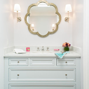 Example of a transitional kids' bathroom design in San Francisco with an undermount sink, recessed-panel cabinets and white cabinets