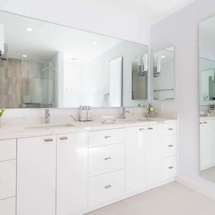 Large minimalist master porcelain floor and white floor bathroom photo in Los Angeles with flat-panel cabinets, white cabinets, white walls, an undermount sink, engineered quartz countertops and multicolored countertops