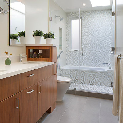 Inspiration for a contemporary white tile and mosaic tile bathroom remodel in San Francisco with flat-panel cabinets, medium tone wood cabinets and quartz countertops