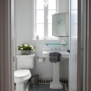 Photo of a mid-sized mediterranean bathroom in San Francisco with a pedestal sink, an alcove shower, multi-coloured tile, terra-cotta tile, white walls, terra-cotta floors, a two-piece toilet and blue floor.