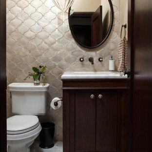 サンフランシスコの小さい地中海スタイルのおしゃれなバスルーム (浴槽なし) (セラミックタイル、グレーのタイル、アンダーカウンター洗面器、シェーカースタイル扉のキャビネット、濃色木目調キャビネット、大理石の洗面台、ベージュの壁、大理石の床、分離型トイレ) の写真