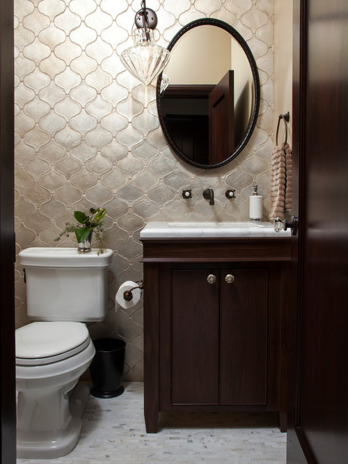 example of a small tuscan 34 ceramic tile and gray tile marble floor bathroom