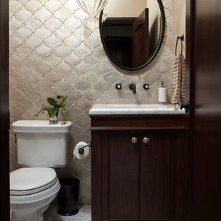 This is an example of a small mediterranean shower room bathroom in San Francisco with ceramic tiles, grey tiles, a submerged sink, shaker cabinets, dark wood cabinets, marble worktops, beige walls, marble flooring and a two-piece toilet.