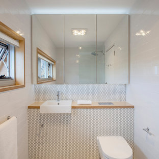 Inspiration for a contemporary 3/4 bathroom in Sydney with a wall-mount toilet, white walls, mosaic tile floors and white floor.