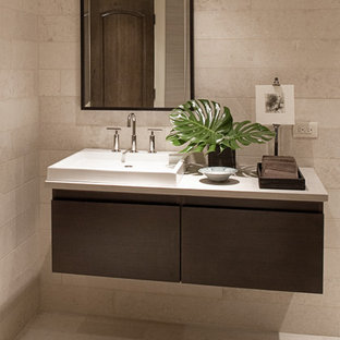 Large trendy beige tile and stone tile limestone floor bathroom photo in Chicago with a vessel sink, dark wood cabinets, limestone countertops, beige walls and flat-panel cabinets
