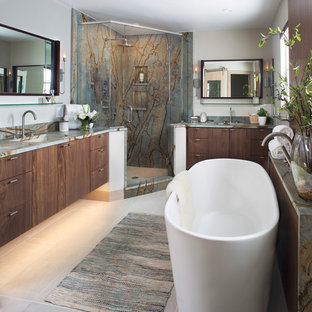 Inspiration for a contemporary master multicolored tile and stone slab beige floor bathroom remodel in Denver with flat-panel cabinets, dark wood cabinets, gray walls, an undermount sink, a hinged shower door and multicolored countertops