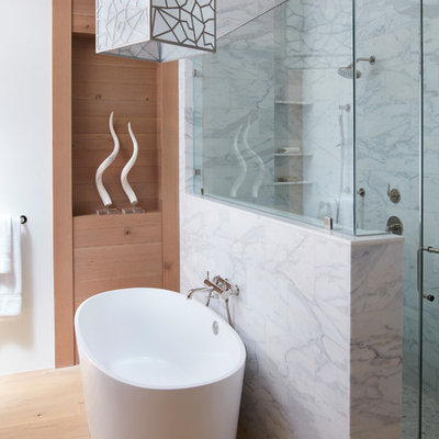 Mid-sized trendy master gray tile, white tile and marble tile medium tone wood floor and brown floor bathroom photo in San Francisco with white walls, a hinged shower door, flat-panel cabinets, medium tone wood cabinets, a two-piece toilet, an undermount sink and marble countertops