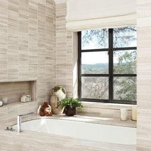 Inspiration for a contemporary alcove bathtub remodel in Austin