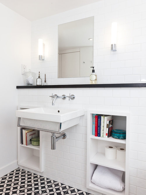 traditional bathroom in london with white tiles metro tiles and a wall mounted sink