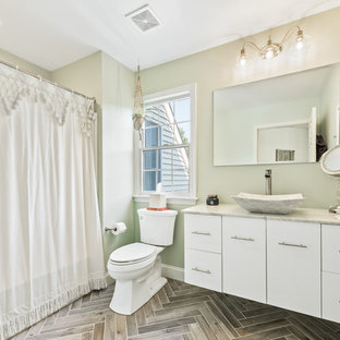 Inspiration for a transitional 3/4 gray floor bathroom remodel in Philadelphia with flat-panel cabinets, white cabinets, a two-piece toilet, green walls, a vessel sink and gray countertops