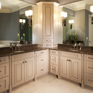 Inspiration for a large timeless master ceramic floor and beige floor bathroom remodel in Charlotte with granite countertops, gray walls, raised-panel cabinets, beige cabinets and an undermount sink