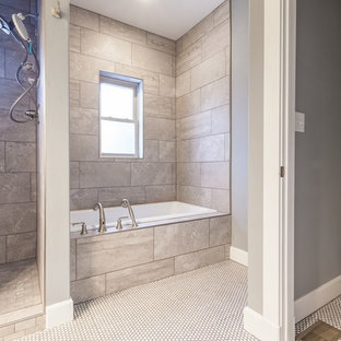 Bathroom - mid-sized craftsman 3/4 gray tile and porcelain tile ceramic tile and white floor bathroom idea in Albuquerque with shaker cabinets, medium tone wood cabinets, a two-piece toilet, gray walls, a drop-in sink, laminate countertops and white countertops