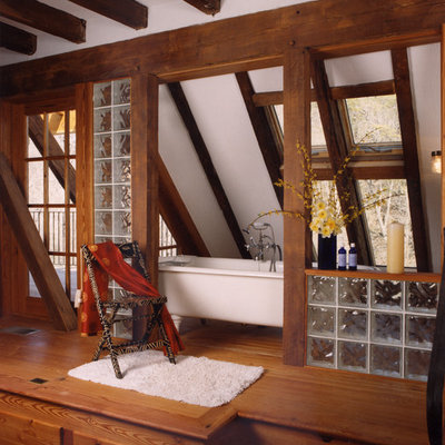 Inspiration for a rustic master medium tone wood floor freestanding bathtub remodel in Richmond