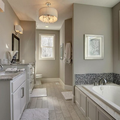 Large transitional master black tile, gray tile, white tile and mosaic tile porcelain tile bathroom photo in Minneapolis with shaker cabinets, white cabinets, a one-piece toilet, gray walls, an undermount sink and granite countertops