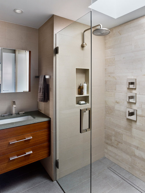 example of a trendy beige tile alcove shower design in with an undermount sink