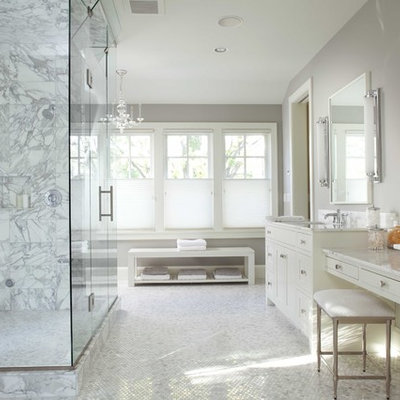 Corner shower - large traditional mosaic tile and white tile mosaic tile floor corner shower idea in Minneapolis with an undermount sink, recessed-panel cabinets, white cabinets, marble countertops, gray walls and white countertops