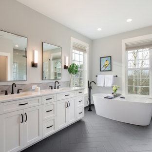 Inspiration for a mid-sized transitional master ceramic tile double-sink and gray floor bathroom remodel in Portland with shaker cabinets, white cabinets, gray walls, an undermount sink, quartzite countertops, white countertops, a built-in vanity and a hinged shower door