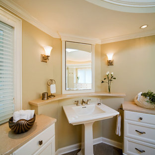 Inspiration for a timeless bathroom remodel in Milwaukee with marble countertops and a pedestal sink
