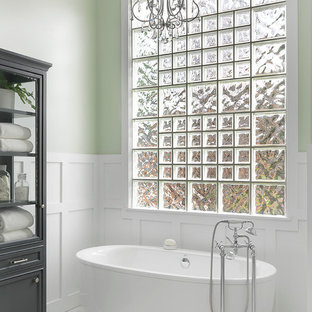 Freestanding bathtub - mid-sized traditional master freestanding bathtub idea in Other with furniture-like cabinets, gray cabinets and green walls